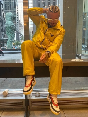 J Balvin Wearing Louis Vuitton Sunglasses With A Yellow Prada Jacket Jacobs Watch And Nike Sneakers