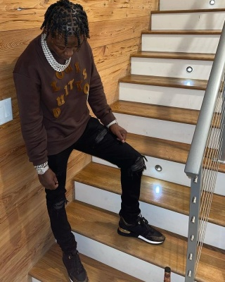 Jackboy Wearing A Brown Louis Vuitton Sweatshirt And Matching Sneakers With Amiri Jeans