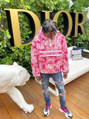 Jackboy Wearing A Dior Fuchsia And White Joy Print Jacket With Amiri Red Underpatch Jeans And Dior Pink Purple B22 Sneakers