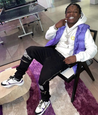 Jackboy Wearing A Dior Purple Puffer White And Yellow Hoodie Belt And Sneakers With Black Amiri Jeans