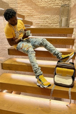 Jackboy Wearing A Fendi Tee With Amiri Jeans And Yellow Sneakers