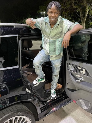 Jackboy Wearing A Green Amiri Bandana Shirt With Amiri Camo Patch Jeans And Dior B22 Sneakers