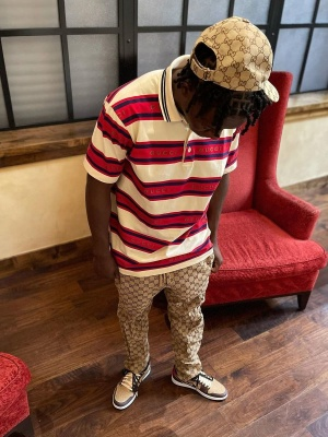 Jackboy Wearing A Gucci Beige Canvas Hat And Pants With A Gucci Striped Polo