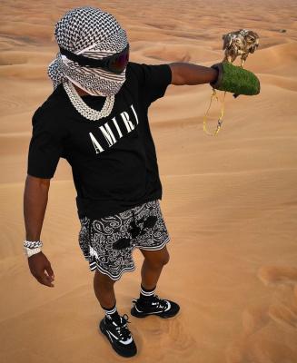 Jackboy Wearing An Amiri Black Core Logo T Shirt Bandana Shorts And Socks With Dior Sneakers