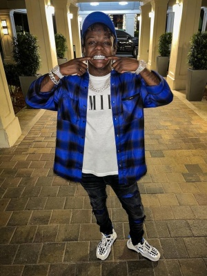 Jackboy Wearing An Amiri Blue And White Star Hat With An Amiri Flannel Shirt Black Jeans And Skeleton Sneakers