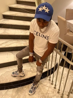 Jackboy Wearing An Amiri Blue Star Hat With A Celine T Shirt Amiri X Playboy Jeans And Amiri Skeleton Sneakers