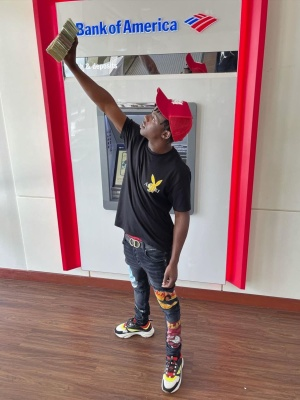 Jackboy Wearing An Amiri Red Ma Hat With An Amiri X Playboy T Shrit And Jeans And Dior B22 Sneakers