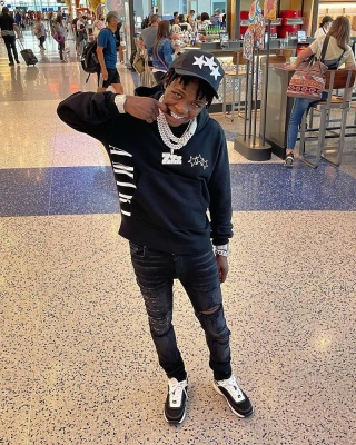 Jackboy Wearing An Amiri Trucker Hat Hoodie And Jeans With Chanel Sneakers