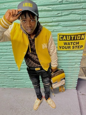 Jackboy Wearing An Amiri Trucker Hat Jacket And Jeans With A Fendi Hoodie And Nike Dunks