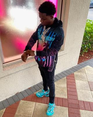 Jackboy Wearing An Neon Logo Balmian Hoodie With Neon Blue Balenciaga Track Sneakers