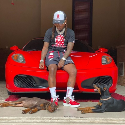 Jacquees Sits Atop His Ferrari In Full Bape X Coca Cola Fit