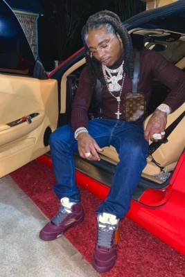 Jacquees Wearing A Burgundy Turtleneck With Brown Monogram Utility Harness Blue Jeans And Burgundy Jordan 1s