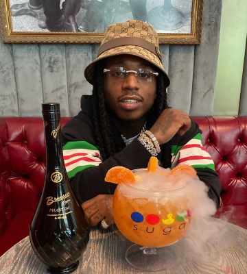 Jacquees Wearing A Gucci Beige And Brown Gg Bucket Hat And Black Striped Panel Hoodie