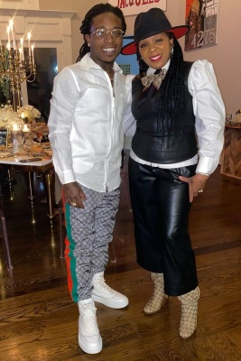 Jacquees Wearing A White Zip Shirt With Gucci Grey Gg Jogging Pants And Prada High Tops