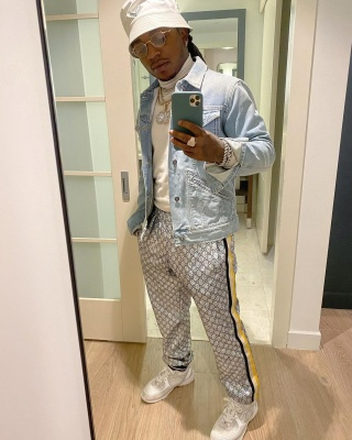 Jacquees Wearing Aprada Bucket Hat Givenchy Denim Jacket Gucci Laminated Pants And Chanel Sneakers