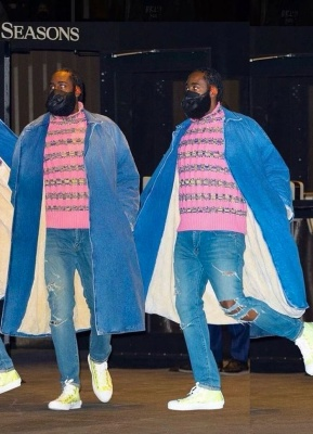 James Harden Wearing A Blue Denim Trench Coat With A Pink Dior Turtleneck Blue Jeans And Dior White Yellow Oblique High Top Sneakers