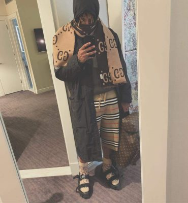Juice Wrld Instagram Photo Wearing A Large Black Coat With A Gucci Scarf And Burberry Shorts