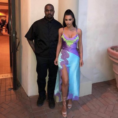 Kanye West Standing With Kim Kardashian Wearing A Black Prada Short Sleeve Button Fron Shirt
