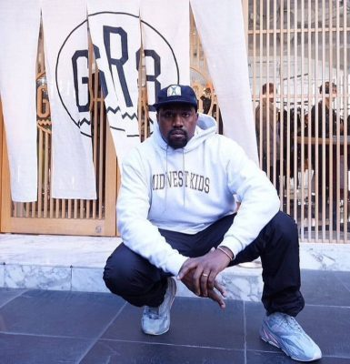Kanye West Wearing A Grey Or White Midwest Kids Hoodie