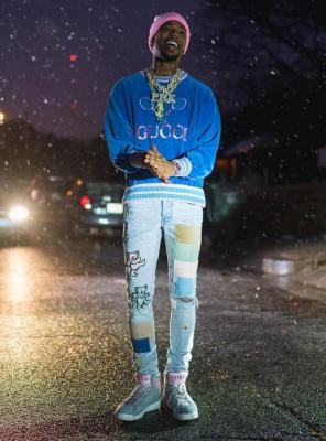 Key Glock Wearing A Gucci Blue Tennis Sweatshirt With Amiri Jeans And Jordan 7 Hare 2 Sneakers