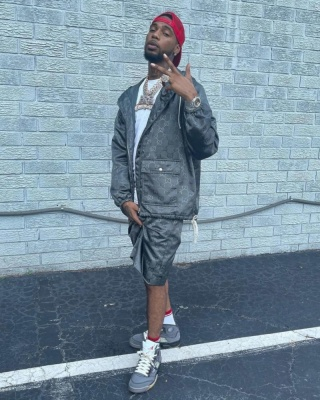 Key Glock Wearing A Gucci Off The Grid Jacket And Shorts With Gucci Socks And Jordan Sneakers