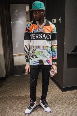 Key Glock Wearing A Teal New Era Yankees Hat With A Versace Logn Sleeve Polo Black Jeans And Jordans