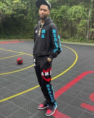 Key Glock Wearing An Amiri Healthy Mind Hoodie With Black Healthy Body Sweatpants And Jordan 1s