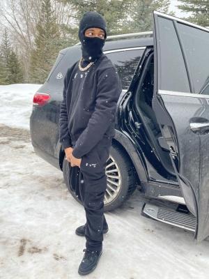 Key Glock Wearing An Off White Peace Sweatshirt Off White Cargo Sweatpants And Jordan 4 Black Sneakers