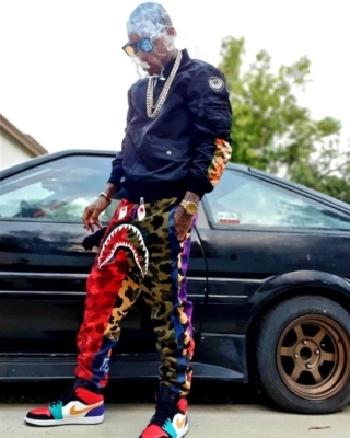 Kid Ink Wearing A Bape Black Bomber Jacket With Bape Multicolor Camo Shark Pants And Multicolor Nike Jordan Sneakers