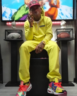 Kid Ink Wearing A Yellow Bbc Hoodie Hat And Sweatpants With Nike Sneakers