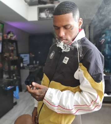 Kid Ink Wearing An Adidas X Evisen Jacket In Black And Gold