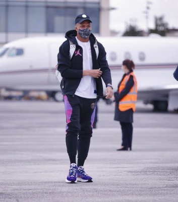 Killian Mbappe Wearing A Jordan X Psg Hoodie And Joggers With Nike X Sacai Sneakers