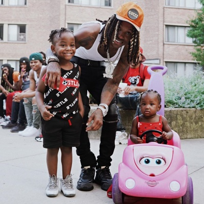 King Von Takes Pictures With Fans In Gucci Louis Vuitton And Amiri