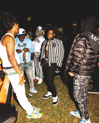 Kodak Black Wearing A Balmain Striped Bomber With A Luois Vuitton Belt And Jordan Concord Sneakers