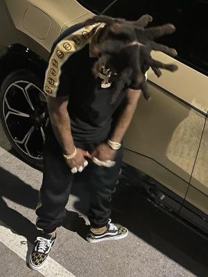 Kodak Black Wearing A Guccci Black Gg Stripe Polo And Trackpants With Beige Gg Socks And Black Sneakers