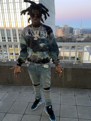 Kodak Black Wearing An Amiri Eagle Sweatshirt With Amiri Clay Indigo Biker Jeans And Jordan Tie Dye Sneakers