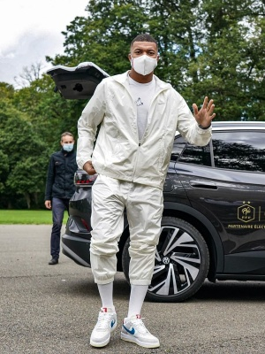 Kylian Mbappe Wearing A Nike Gold X Nocta Ivory Track Jacket And Trackpants With Air Force 1 Sneakers