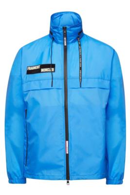 Light Blue Moncler Jacket With Black Logo Worn By Slim Jxmmi