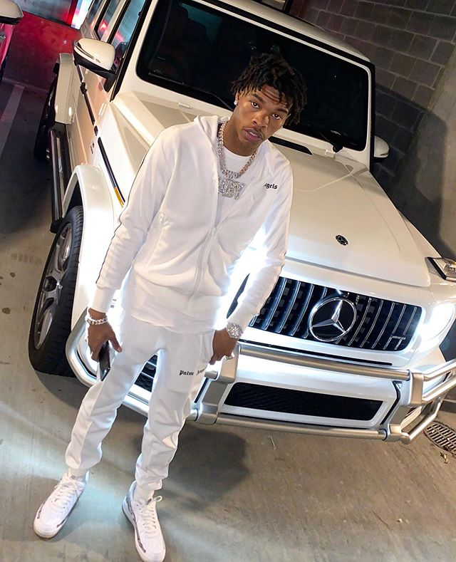 Lil Baby Matches Hid G Wagon In A White Palm Angels Hoodie And Track Pants