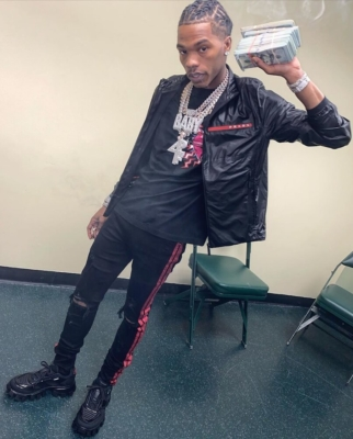 Lil Baby Wearing A Black Nylon Jacket With Amiri Jeans And Prada Cloudbust Thunder Black Sneakers