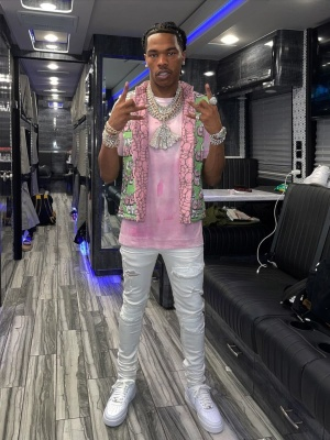 Lil Baby Wearing A Cdg X Kaws Vest With A 1017 Alyx 9sm Pink Tee White Amiri Jeans And Nike Air Force 1 Sneakers