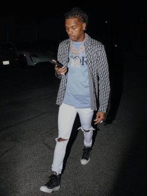 Lil Baby Wearing A Dior Oblique Overshirt With A Light Blue Logo T Shirt And Crystal B23 Sneakers