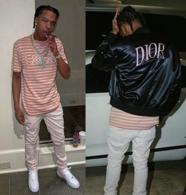 Lil Baby Wearing A Dior X Daniel Arsham Bomber Jacket And A Dior Pink And White Striped T Shirt