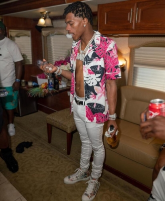 Lil Baby Wearing A Floral Valentino Shirt With White Jeans And A Dior Sneakers
