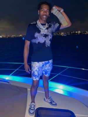 Lil Baby Wearing A Louis Vuitton Navy Watercolor Monogram T Shirt Shorts And Sneakers