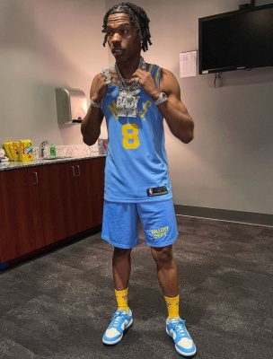 Lil Baby Wearing A Minneapolis Lakers Jersey With Gallery Dept Shorts And Nike Dunk Unc Sneakers