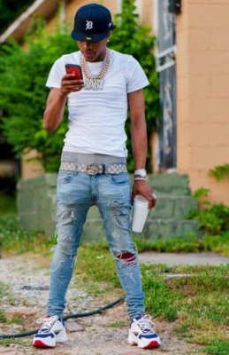 Lil Baby Wearing A White Tee With A Detroit Tigers New Era Hat Jeans Gucci Belt And Dior Sneakers