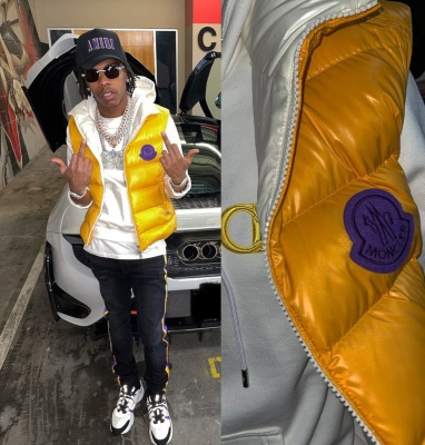 Lil Baby Wearing An Amiri X Lakers Black Hat And Black Jeans A Moncler Puffer Jacket Dior White Yellow Hoodie And Dior B22s