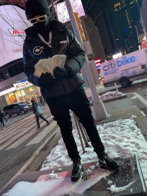Lil Baby Wearing Off White Eazy Sunglasses With A Moncler X Frament Puffer And Nike X Off White Sneakers