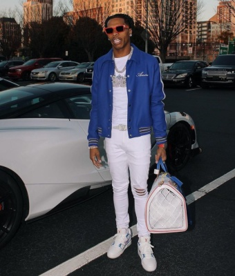 Lil Baby Wearing Red Lv Sunglasses With White Lv Sneakers Belt And Bag And An Amiri Blue Skeleton Jacket